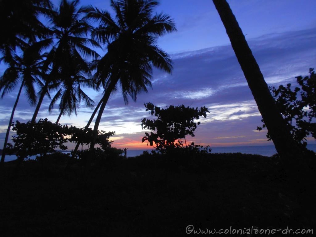 A man praising God during the sunrise over the Caribbean Sea at Punta Torrecilla in Santo Domingo Este.