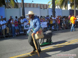 farmer walking slow with cow carnival dominicano 2012