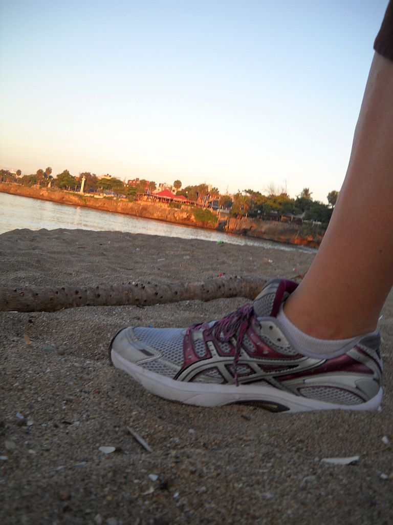 The sun rising on my new tennis at Playita Montecino
