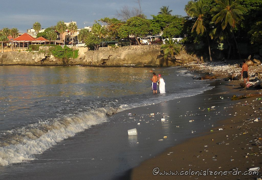 Lady in White doing a type of baptism at Playita Montecino