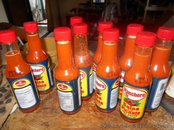 Almost 2 pounds of chilies cooked down into fiery sauce in bottles.