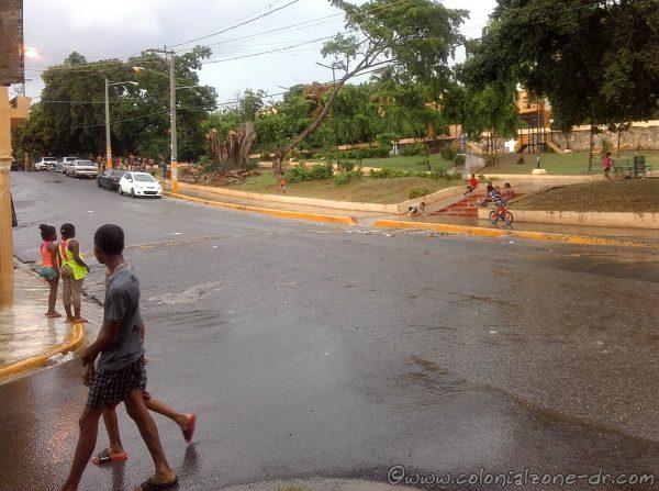 The rain stopped but the kids are still  playing at Parque La Francia, Villa Duarte in Santo Domingo Este