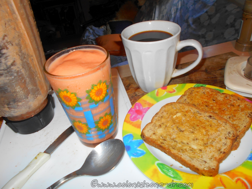Breakfast. Strong black Coffee. Wheat toast with butter. Zapote Batida with Carnation.